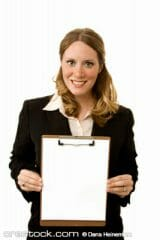 Businesswoman on white holding a clipboard wit...